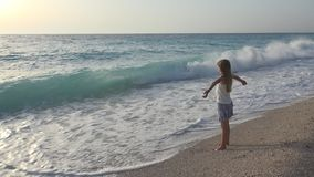 Child Playing on Beach, Girl Looking at Sea Waves, Kid Watching on Seashore.  stock image