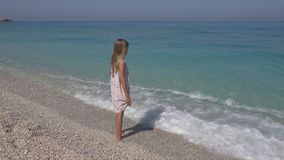 Child Playing on Beach, Girl Looking at Sea Waves, Kid Watching on Seashore.  royalty free stock image