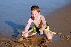 Child Playing in beach sand Royalty Free Stock Photo
