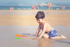 Child playing on the beach. With sand Royalty Free Stock Image