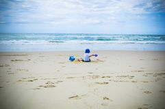 Child playing on a beach stock images