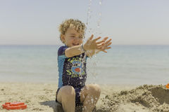 Child playing on the beach Royalty Free Stock Images