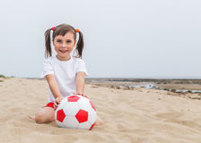 Child playing in beach soccer. Stock Photography