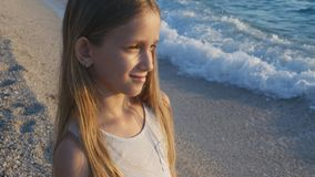 Child Playing on Beach in Sunset, Kid Watching Sea Waves, Girl Portrait on Shore stock photography