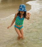 A child playing on a beach in the windward islands Stock Photography