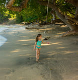 A child playing on a beach in the windward islands Royalty Free Stock Image
