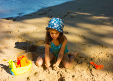A child playing on a beach in the windward islands Royalty Free Stock Photo