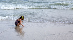 Child playing at beach. Royalty Free Stock Images
