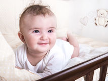 Child playing in a bed Stock Photography