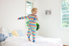 Child playing in bed. Kids room. Baby boy at home royalty free stock photography
