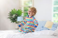 Child playing in bed. Kids room. Baby boy at home stock images