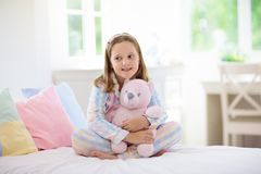 Child playing in bed. Kids room. Girl at home royalty free stock images