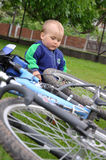 Child playing with bicycle Stock Photo