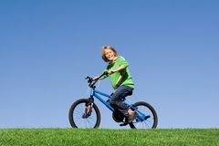 Child playing on bike Royalty Free Stock Photo
