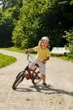 Child playing bike Royalty Free Stock Photography