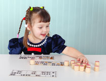 Child playing with bingo at the table Royalty Free Stock Image