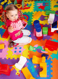 Child playing  block and construction set at home. Royalty Free Stock Photo
