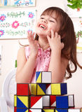 Child playing  block in play room. Stock Images
