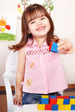 Child playing  block in play room. Royalty Free Stock Photography