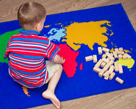 Child playing with blocks Stock Photography
