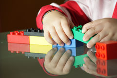 Child playing with blocks. Close up hands royalty free stock photo