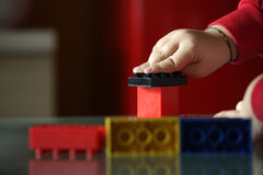 Child playing with blocks. Close up hands royalty free stock photos