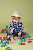 Child Playing with Blocks, Clothing and Fashion Concept Royalty Free Stock Image