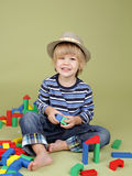 Child Playing with Blocks, Clothing and Fashion Royalty Free Stock Photo
