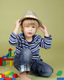 Child Playing with Blocks, Fashion and Clothing Stock Photography