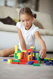 Child playing with blocks Stock Photo