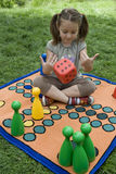 Child playing with a board Stock Photography