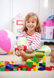 Child playing with bricks royalty free stock photos