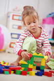 Child playing with bricks Royalty Free Stock Photo