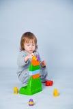Child playing with bricks Stock Image