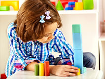 Child playing bricks. Royalty Free Stock Image