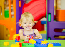 Child  playing with bright plastic construction blocks Stock Photo