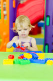 Child  playing with bright plastic construction blocks Stock Images