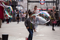 Child playing with bubbles Royalty Free Stock Photo