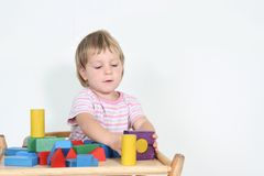 Child playing with building blocks Royalty Free Stock Photo