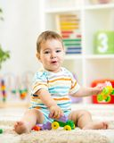 Child playing with building blocks at home Stock Photo