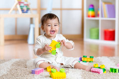 Child playing with building blocks at home Royalty Free Stock Images