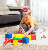 Child playing with building blocks at home. Royalty Free Stock Photo