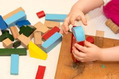 Child playing with building blocks. Child playing with old building blocks royalty free stock images