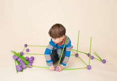 Child Playing and Building a Fort Royalty Free Stock Photos
