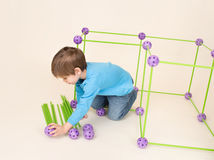 Child Playing and Building a Fort Stock Photography
