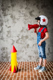 Child playing with cardboard rocket Royalty Free Stock Photography