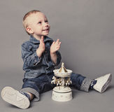 Child playing with carousel toy Stock Image