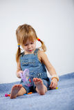 Child playing on carpet Royalty Free Stock Photography