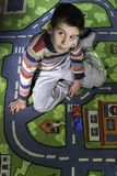 Child is playing with cars Royalty Free Stock Images