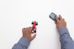 Child playing with cars on white background Royalty Free Stock Photos